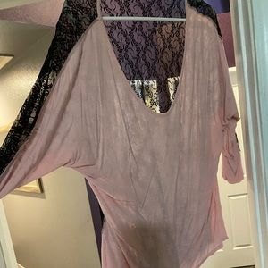 Light pink top with black lace in the back